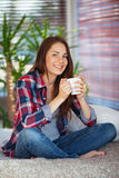 Young woman holding a cup Stock Photos