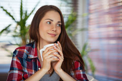 Young woman holding a cup Stock Images