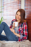 Young woman holding a cup Stock Photo