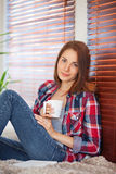 Young woman holding a cup Stock Photography
