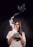 Young woman holding a cup Royalty Free Stock Image