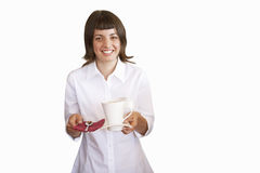 Young woman holding cup and spoon, cut out Stock Image