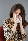 Woman holding a cup of tea Stock Photo