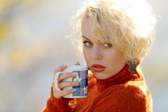 Young woman holding cup of tea Royalty Free Stock Photography