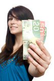 Young woman holding currency Stock Photos