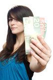 Young woman holding currency Royalty Free Stock Photography