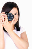 Young woman holding digital camera Stock Photo