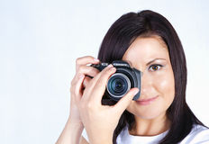 Young woman holding digital camera Stock Images