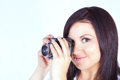 Young woman holding digital camera Royalty Free Stock Photos