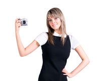 Young woman holding digital camera Royalty Free Stock Image