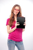 Young woman holding digital tablet. Woman with digital tablet. Cheerful young caucasian woman holding digital tablet and smiling while isolated on white Royalty Free Stock Image