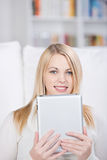 Young Woman Holding Digital Tablet Stock Photo