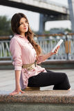 Young woman holding a digital tablet computer Royalty Free Stock Photos