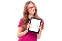Young woman holding digital tablet. Copy space on her digital tablet. Cheerful young caucasian woman holding digital tablet and smiling while isolated on white Stock Image