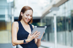 Young woman holding a digital tablet Stock Image