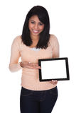 Young woman holding digital tablet Royalty Free Stock Image