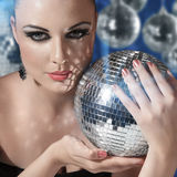 Young woman holding disco ball Stock Photography