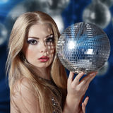 Young woman holding disco ball Royalty Free Stock Photography