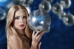 Young woman holding disco ball Royalty Free Stock Image