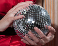 Young woman holding disco ball , close up Royalty Free Stock Photos