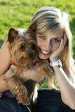Young woman holding dog Stock Photography