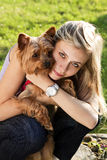 Young woman holding dog Royalty Free Stock Image