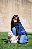 Young woman holding a dog royalty free stock images