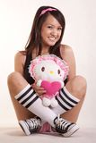 Young woman holding doll Royalty Free Stock Photography