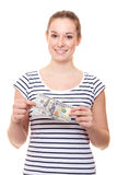 Young woman holding 200 dollar Stock Photos