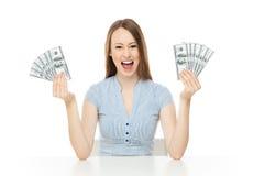 Young woman holding dollar bills Stock Photos