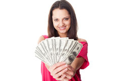Young woman holding a dollar bills. Portrait of pretty young smiling woman holding a dollar bills isolated on white background Royalty Free Stock Images