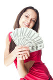 Young woman holding a dollar bills. Portrait of pretty young smiling woman holding a dollar bills isolated on white background Stock Photo