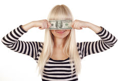 Young woman holding dollar over her eyes Royalty Free Stock Image