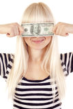 Young woman holding dollar over her eyes Stock Images