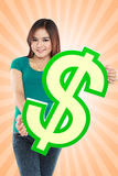 Young woman holding dollar sign Stock Photography