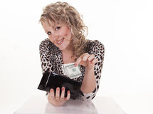 Young woman holding dollars in her wallet Royalty Free Stock Images