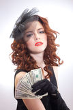 Young woman holding dollars money Stock Photo