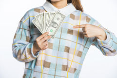 Young woman holding dollars and piggy bank, savings imagery Royalty Free Stock Photo