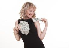 Young woman holding dollars Stock Photos