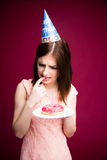 Young woman holding donut with candle Royalty Free Stock Photography