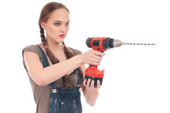 Young woman holding drill with auger stock photo