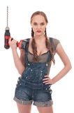 Young woman holding drill with auger Stock Photography