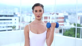Young woman holding dumbbells stock footage