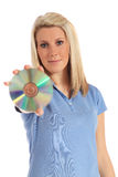 Young woman holding a DVD Stock Image