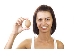 Young woman holding egg Royalty Free Stock Photos