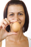 Young woman holding egg stock photography