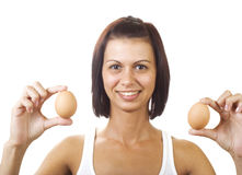 Young woman holding eggs Stock Photos