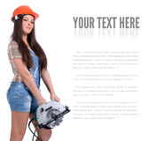 Young woman holding an electric circular disk saw. Stock Image