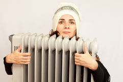 Young woman holding an electric heater Royalty Free Stock Photos