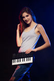 Young woman holding an electronic mini piano Stock Images